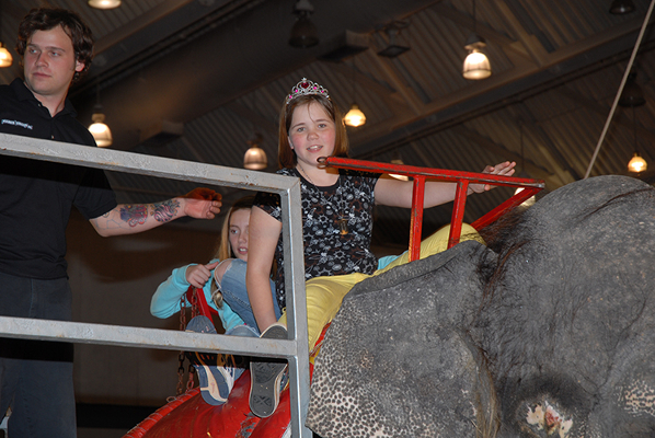 Past queen of the circus riding an elephant.